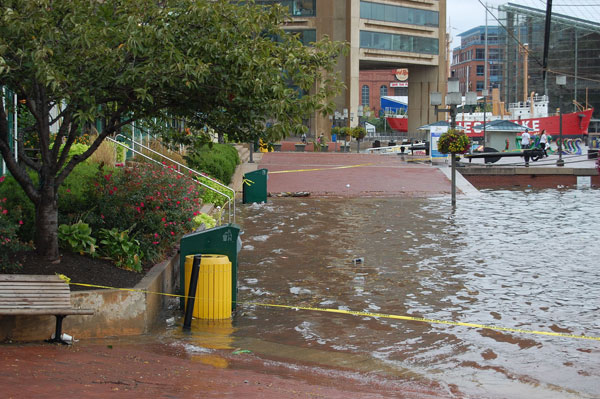 Baltimore's Inner Harbor flooding during a rainstorm