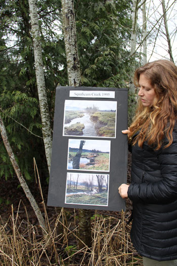 N-SEA Executive Director Rachel Vasak displaying photos of Washington's Squalicum Creek