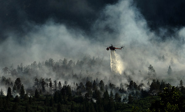 A helicopter drops water on the Waldo Canyon Fire on June 27, 2012