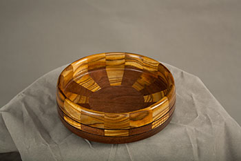 Jim Kuebelbeck used pieces of leftover sumac from the table and black walnut to complete the bowl. Photo: Elena Neuzil.