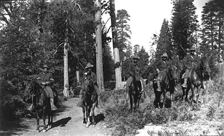 Five U.S. Army soldiers of the 24th Mounted Infantry, mounted on horses in Yosemite National park.