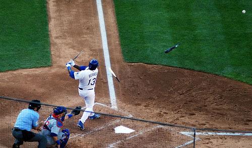 Ángel Berroa breaks a bat