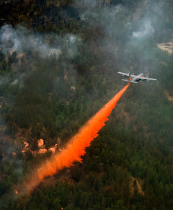 The 153rd Airlift Wing from Cheyenne, Wyo., use a modular air firefighting system-equipped C-130 Hercules aircraft in support of the Waldo Canyon Fire in Colorado Springs, Colo. on June 27, 2012.