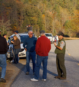 Yarkovich (right) speaks with park visitors in Great Smoky Mountains National Park