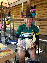 A rider gets food for the road at Brush Mountain Lodge and Outpost.