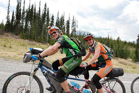 "Jay and Tracey Petervary on their tandem bicycle, ""the loveshack."""