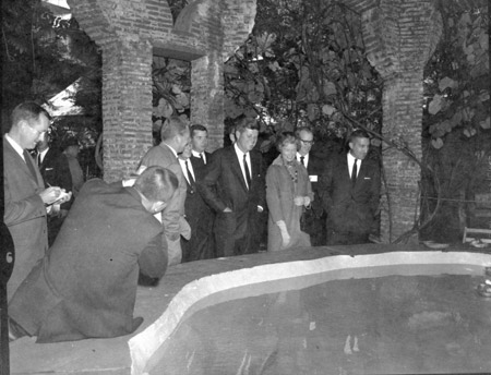 President Kennedy with Dr. and Mrs. Pinchot at the Finger Bowl where historic conversations were held.