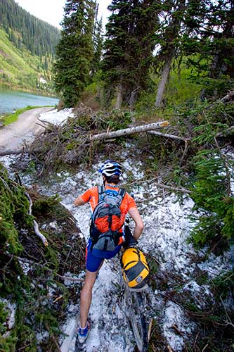 Rider Matthew Lee climbs through the snow and debris left from an avalanche at Red Meadow Pass in Montana