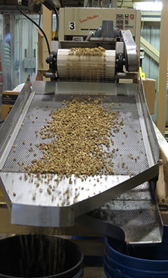 At Hammons Products Company, 25 million pounds of walnuts are processed each year. This machinery is part of the sorting process that separates nut pieces based on their size.
