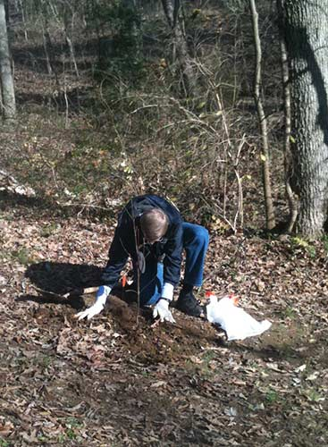 An Alcoa Foundation employee plants a dogwood as part of the Bazillion Blooms project.