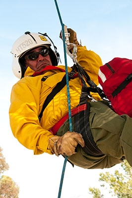 The Forest Service's new helicopter rappel descent device aims to deliver firefighting crews to the scene of wildfires more safely.