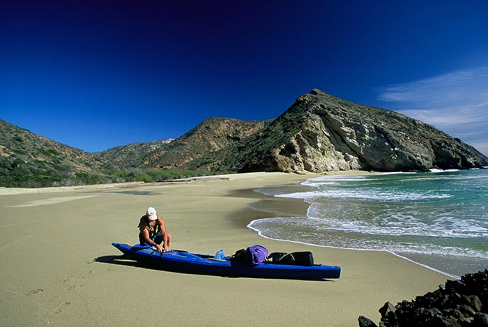 Chuck Graham on Santa Cruz Island with kayak