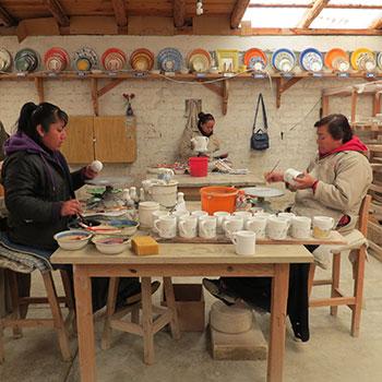 Handpainting dishware at Estanzuela Ceramics Studio