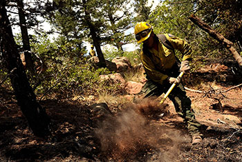 Hotshot firefighter Lupe Covarrubias cuts a fire line to help battle the Waldo Canyon Fire in June 2012.