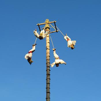 "Performers in the ceremony of El Palo Volador, ""the pole flyer"""