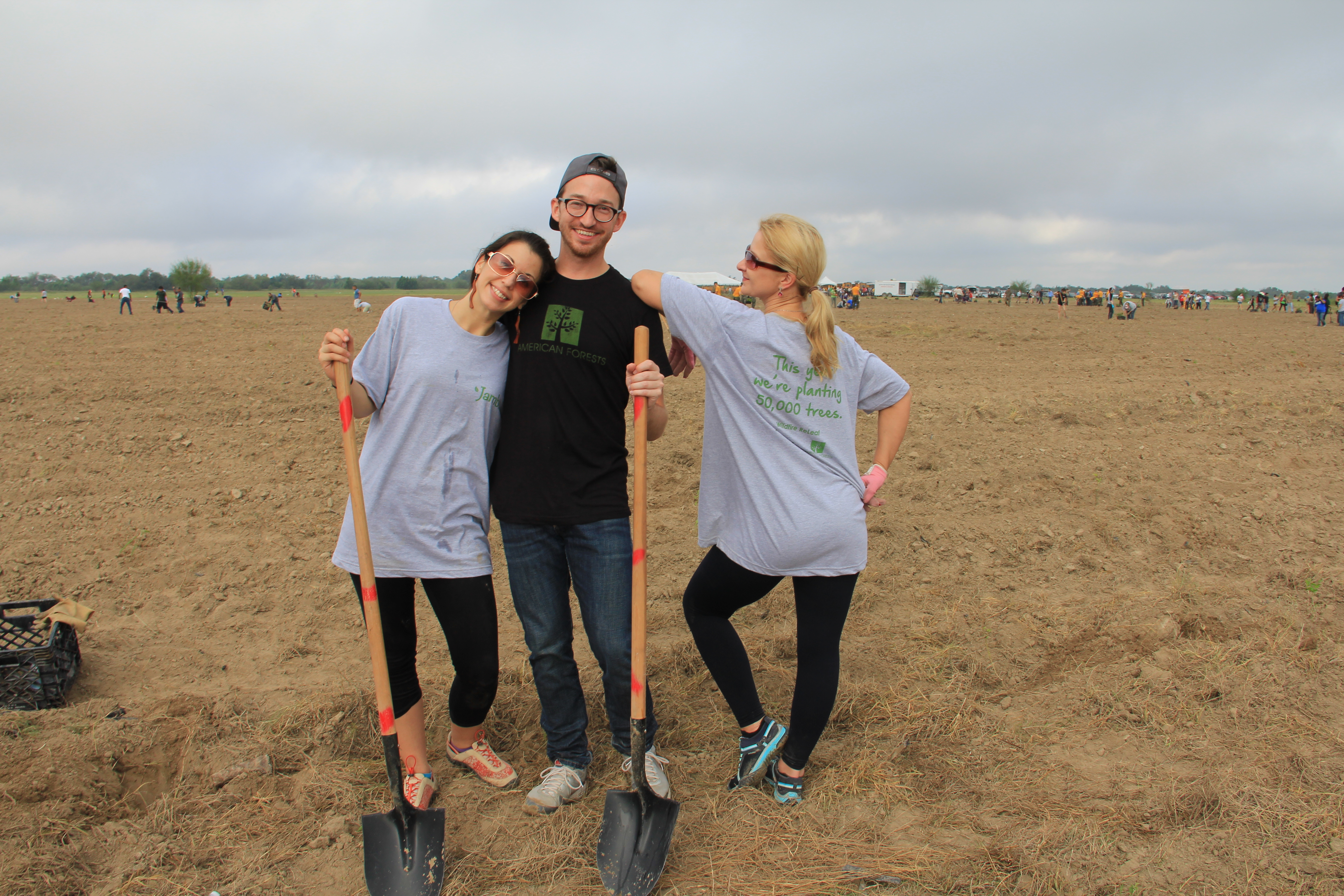 American Forests staff and Volunteers standing in empty field with shovels