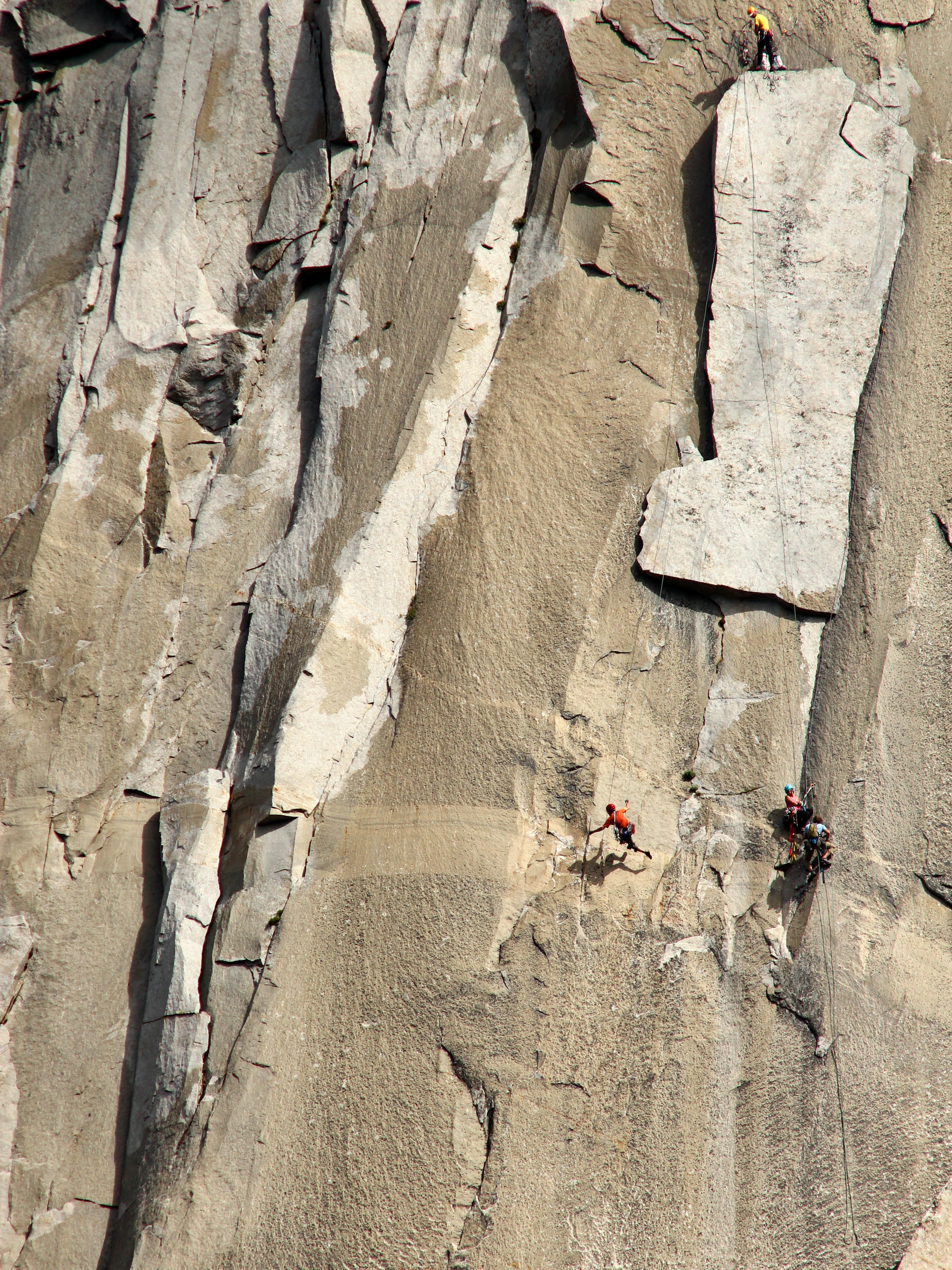 Ben Ditto (orange shirt) runs back and forth to complete the king swing on El Capitan's famous nose route.