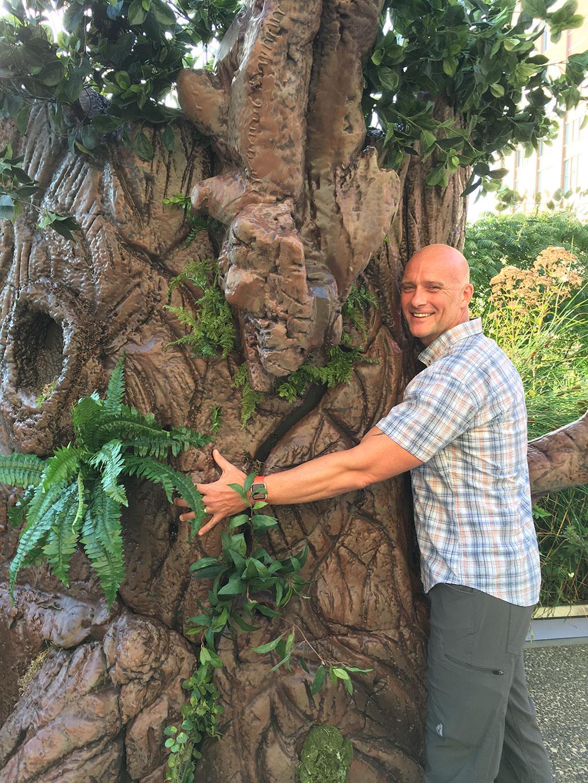 Matthew Boyer hugging tree