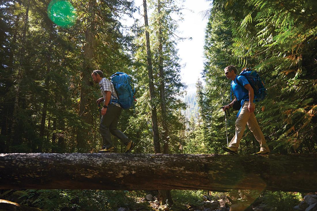 Eddie Bauer Guides David Morton (left) and Jake Norton (right) hiking in the North Cascades in Washington.