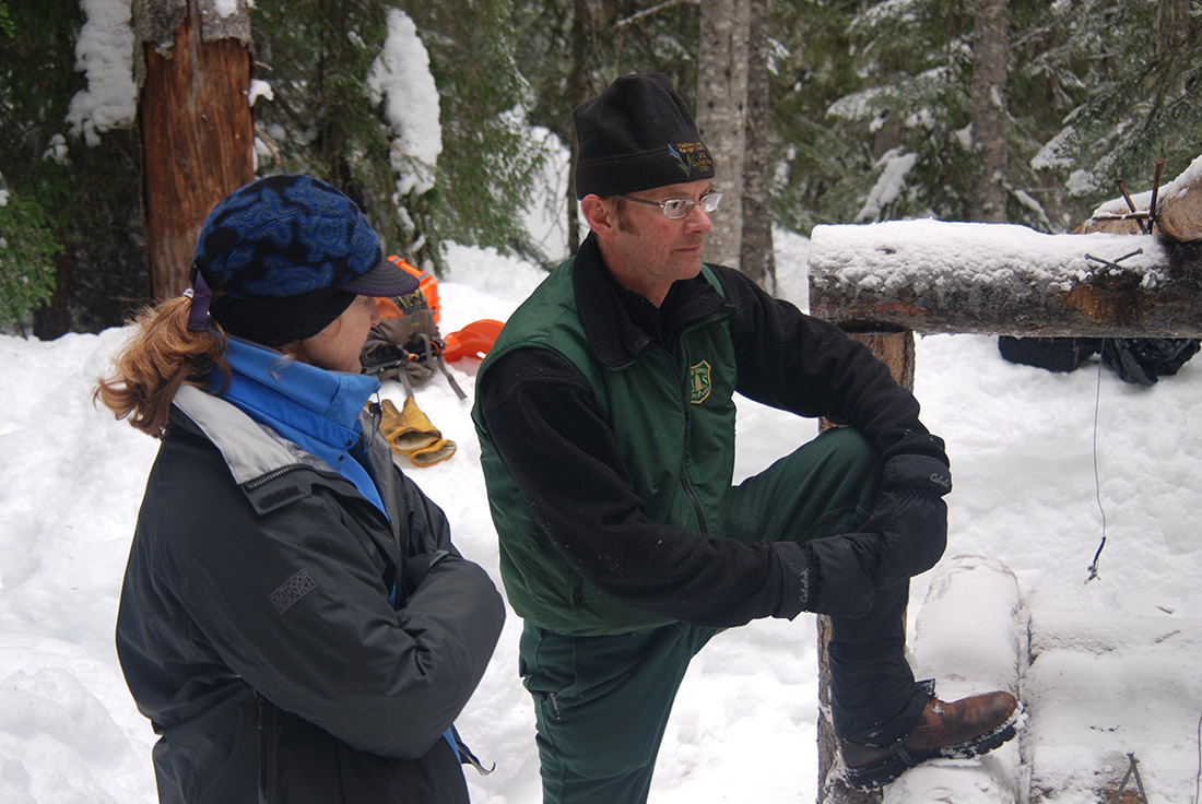 Cathy Raley and John Rohrer converse at the Easy Pass trap site.