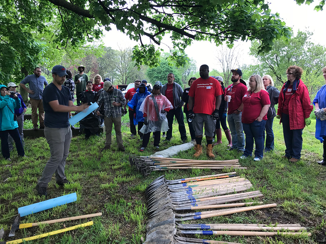 Volunteers from Bank of America gather before planting 200 seedlings in Detroit in May 2018.