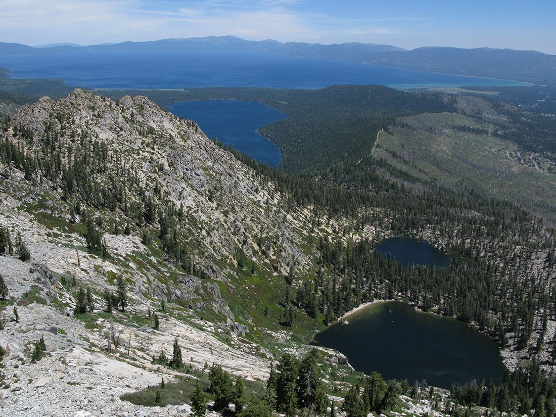 The Angora Lakes are in the foreground, and the ridge where Bunnett stopped the Angora Fire is clearly visible, with Fallen Leaf Lake off to the left and Lake Tahoe in the distance.