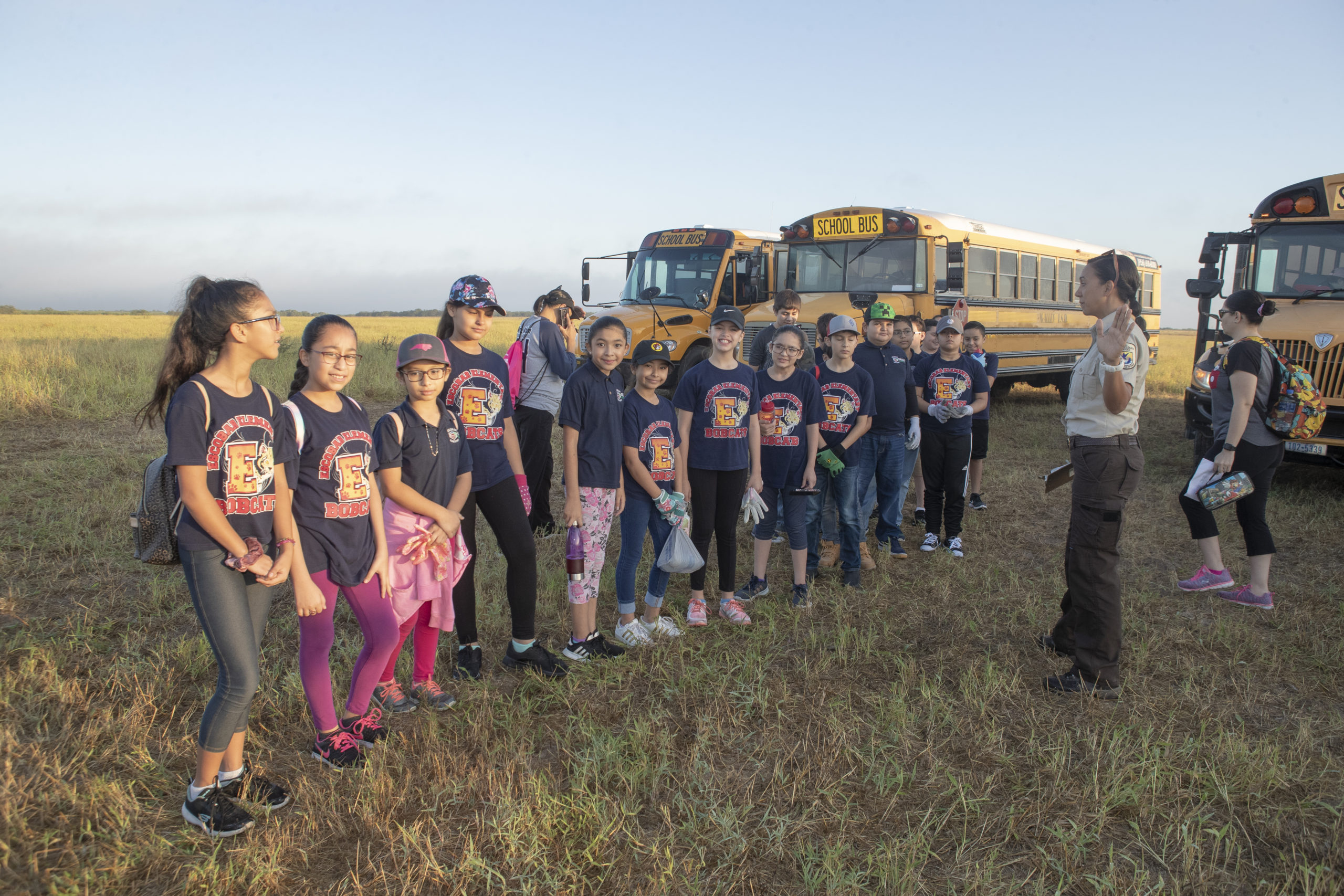 Young volunteers deboard school buses in La Sal del Rey and prepare to begin planting as part of Rio Reforestation 2019.