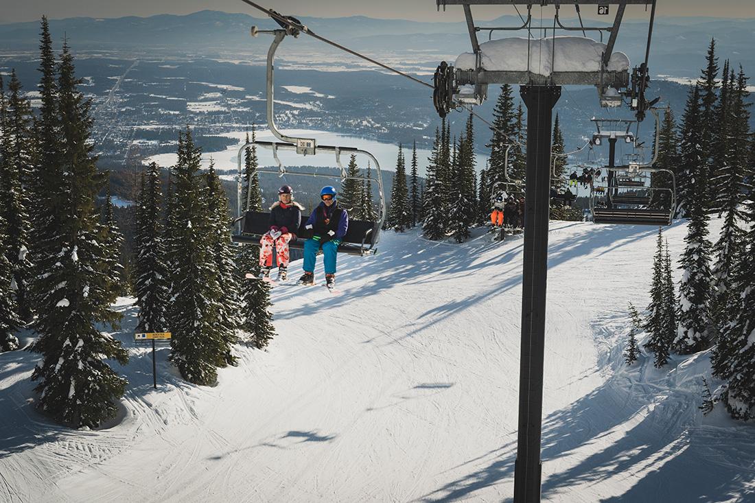 Skiers enjoy the abundant snow that whitebark pine trees help to retain at The Whitefish Mountain Resort.