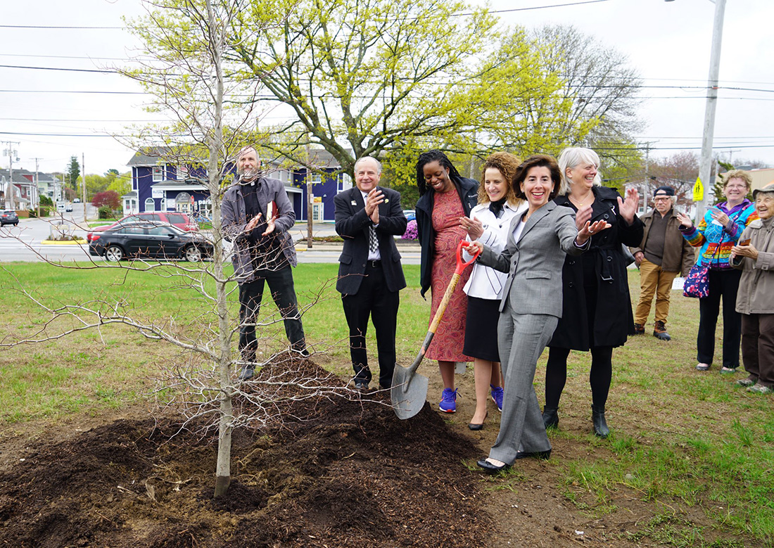Raimondo volunteers at a tree planting event in Woonsocket, R.I. on Arbor Day 2019.