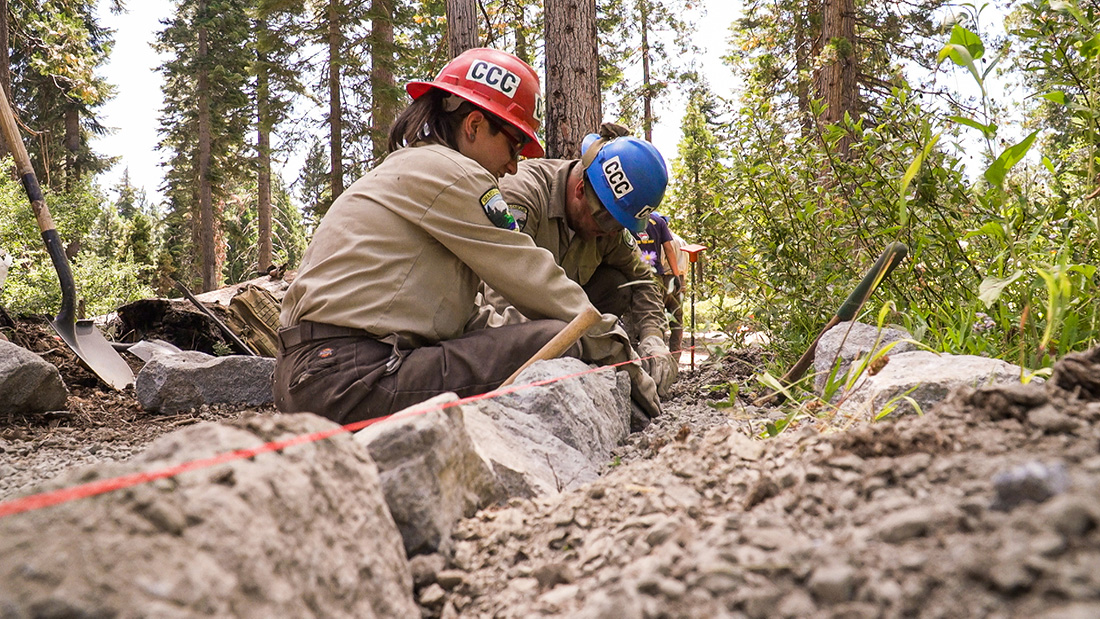 California Conservation Corps members rebuild a trail around Madora Lake in Pluma- Eureka State Park near Graeagle, Calif., to meet Americans with Disabilities Act (ADA) accessibility standards.