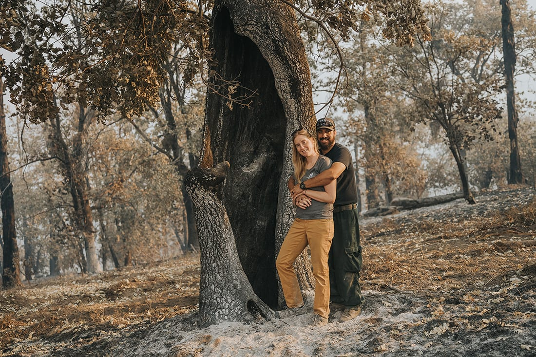 Brittany and Gilbert Dyer stand in the ash of the 2020 Creek Fire, California's largest-ever single fire.