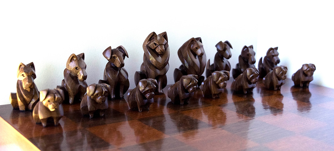 Canadian-based sculptor Patricia Aitkenhead's carved animals make popular pendants and totems. But her business started with a classic debate: cats or dogs? As a way to settle the issue, she crafted a chess set comprised of a team of cats and a team of dogs. She chose breeds with traits she thought might fit their position on the board. Here, these pugs are the pawns.